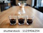 espresso coffee at table | Shutterstock . vector #1125906254