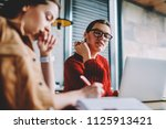 young interested hipster girl...   Shutterstock . vector #1125913421