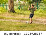 running boy playing with the... | Shutterstock . vector #1125928157