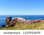 lange anna sea stack rock on... | Shutterstock . vector #1125933659