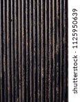 oil drill pipe. rusty drill... | Shutterstock . vector #1125950639