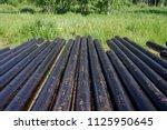 oil drill pipe. rusty drill... | Shutterstock . vector #1125950645