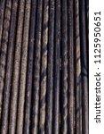 oil drill pipe. rusty drill... | Shutterstock . vector #1125950651