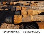 oil drill pipe. rusty drill... | Shutterstock . vector #1125950699