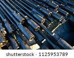 oil drill pipe. rusty drill... | Shutterstock . vector #1125953789