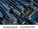 oil drill pipe. rusty drill... | Shutterstock . vector #1125953795
