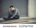 unemployed businessman stress... | Shutterstock . vector #1125967934