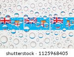 flags  of fiji behind a glass...   Shutterstock . vector #1125968405