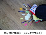 open black backpack lying on... | Shutterstock . vector #1125995864