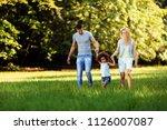 happy young couple spending... | Shutterstock . vector #1126007087