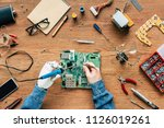 cropped image of electronic...   Shutterstock . vector #1126019261