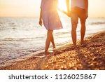 Young Happy Couple On Seashore...