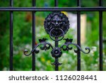 wrought iron gates  ornamental... | Shutterstock . vector #1126028441