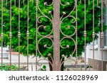 wrought iron gates  ornamental... | Shutterstock . vector #1126028969