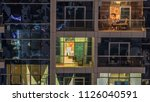 glowing windows of skyscrapers... | Shutterstock . vector #1126040591