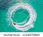 people are playing jet ski at... | Shutterstock . vector #1126070864