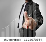 businessman with financial... | Shutterstock . vector #1126070954