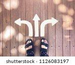 selfie feet on wooden... | Shutterstock . vector #1126083197