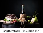 flask of wine on a table with... | Shutterstock . vector #1126085114