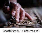 hands of craftsman carve with a ... | Shutterstock . vector #1126096145