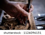 hands of craftsman carve with a ... | Shutterstock . vector #1126096151