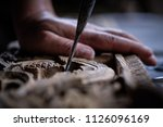 hands of craftsman carve with a ... | Shutterstock . vector #1126096169