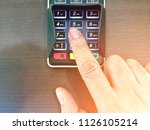 a man press button number on... | Shutterstock . vector #1126105214