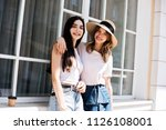 friends for a walk  attractive... | Shutterstock . vector #1126108001