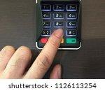 a man using finger press button ... | Shutterstock . vector #1126113254