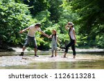 family to play in the river | Shutterstock . vector #1126113281