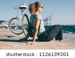 young woman sitting on wooden... | Shutterstock . vector #1126139201