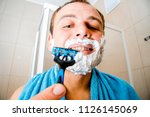 a young man in the bathroom... | Shutterstock . vector #1126145069