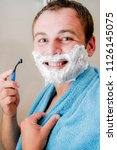 a young man in the bathroom... | Shutterstock . vector #1126145075