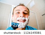 a young man in the bathroom... | Shutterstock . vector #1126145081