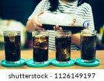 glass of soda waters is a... | Shutterstock . vector #1126149197