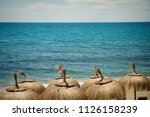 sunshades against the backround ... | Shutterstock . vector #1126158239