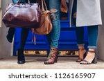 three women wearing stylish...   Shutterstock . vector #1126165907