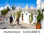 tourists visiting the trulli ... | Shutterstock . vector #1126168871