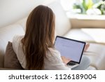 woman using laptop for typing... | Shutterstock . vector #1126189004