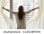 rear view at rich woman... | Shutterstock . vector #1126189454