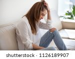 sad depressed thoughtful young... | Shutterstock . vector #1126189907