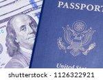 usa passport with cash money...