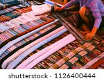 hand woven lao silk scarfs sold ... | Shutterstock . vector #1126400444