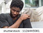 man suffering from neck pain ... | Shutterstock . vector #1126445081
