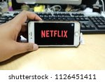 Small photo of KUALA LUMPUR,MALAYSIA-04.07.2018 : Man opening Netflix in her smartphone. Millennial man resting with her cell phone in her hands and the Netflix logo in the screen.