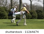 two young men playing golf - stock photo