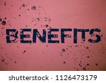 Small photo of Handwriting text Benefits. Concept meaning Advantage Insurance Compensation Interest Revenue Gain Aid Ideas messages pink background splatters messy paint communicate feelings.