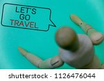 Small photo of Word writing text Let'S Go Travel. Business concept for Going away Travelling Asking someone to go outside Trip Cyan background robot imaginations idea message template thoughts doll.
