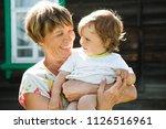 happy grandmother with her... | Shutterstock . vector #1126516961