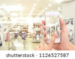 woman hands taking a picture... | Shutterstock . vector #1126527587
